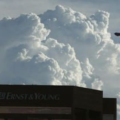 Thunderheads and a dust storm moves to the northwest
