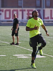 Larry Fitzgerald completed a two-hour workout at the University of Minnesota before showing visitors around his hometown.