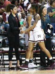 MSU student assistant coach Dominique Dillingham greets  Mississippi State's Jazzmun Holmes (10) as she returns to the bench. Mississippi State played Nicholls in the first round of the NCAA Women's basketball tournament at Humphrey Coliseum on Saturday, March 17, 2018. Photo by Keith Warren