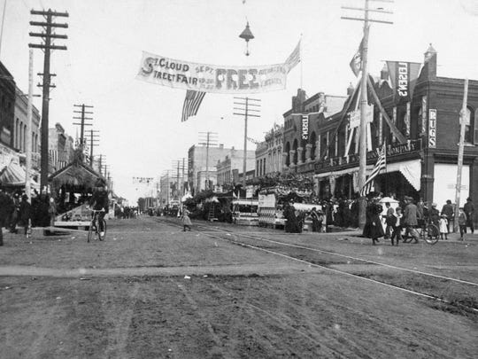 St. Cloud Street Fair, which began in 1898, attracted residents downtown for free entertainment. In it's second year, the Street Fair added fireworks and dancing in Empire Park. Shown in 1899 is the Street Fair at the corner of Seventh Avenue North and St. Germain Street