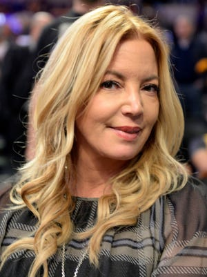 Lakers President Jeanie Buss sits courtside at the season-opener Tuesday against the Rockets.