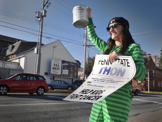 In this file photo, Adrien Aloi tries to attract attention for the THON fundraiser during her stint last year at Forrest and Main in Shrewsbury.