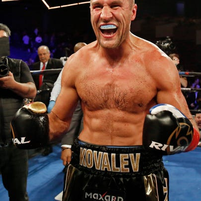 Sergey Kovalev celebrates after defeating Igor Mikhalkin in the seventh round of a WBO light heavyweight title boxing match Saturday, March 3, 2018, in New York. (AP Photo/Adam Hunger)