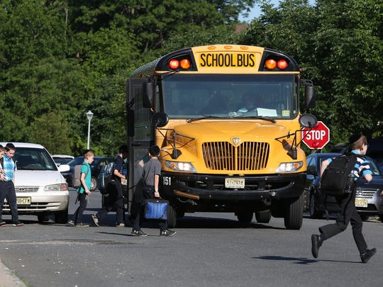 A school bus picks up students in Lakewood, New Jersey. Tuesday, June 5, 2018. David Gard /Correspondent