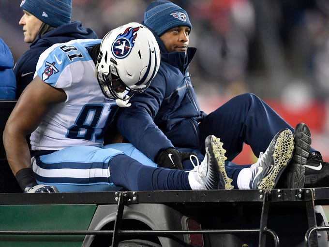 Titans tight end Jonnu Smith (81) is carted off the