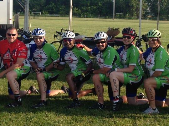 Members of Shore Velocity honor Bob Maddux, their injured
