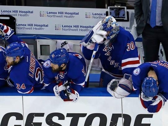Rangers goalie Henrik Lundqvist (30) can't look from