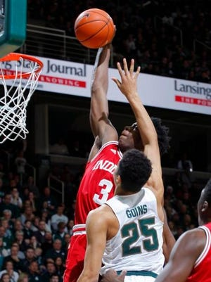 Indiana's OG Anunoby (3) goes up for a dunk against Michigan State's Kenny Goins (25) during the first half of an NCAA college basketball game Sunday. The redshirt freshman forward suffered what appeared to be a painful left knee injury in the first half. He was helped to the locker room with 10:36 remaining and did not return to the floor.