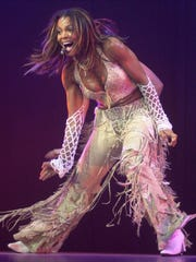 Janet Jackson performs at the Palace in Auburn Hills, Mich., Tuesday, July 31, 2001, during a stop on her All For You concert tour. (AP Photo/Paul Warner)
