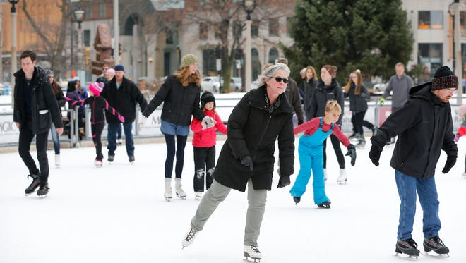 Skaters take advantage of the balmy weather at Slice of Ice in Red Arrow Park.