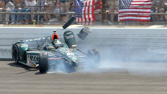 Ed Carpenter (20) of CHF Racing contacts the wall in turn one during the 99th running of the Indianapolis 500, May 23, 2015.