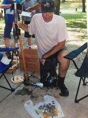 A member of the Michigan Treasure Hunters displays