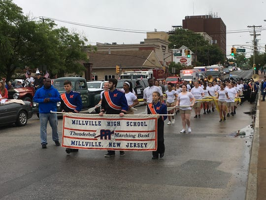 The Millville High School Marching Band plays during