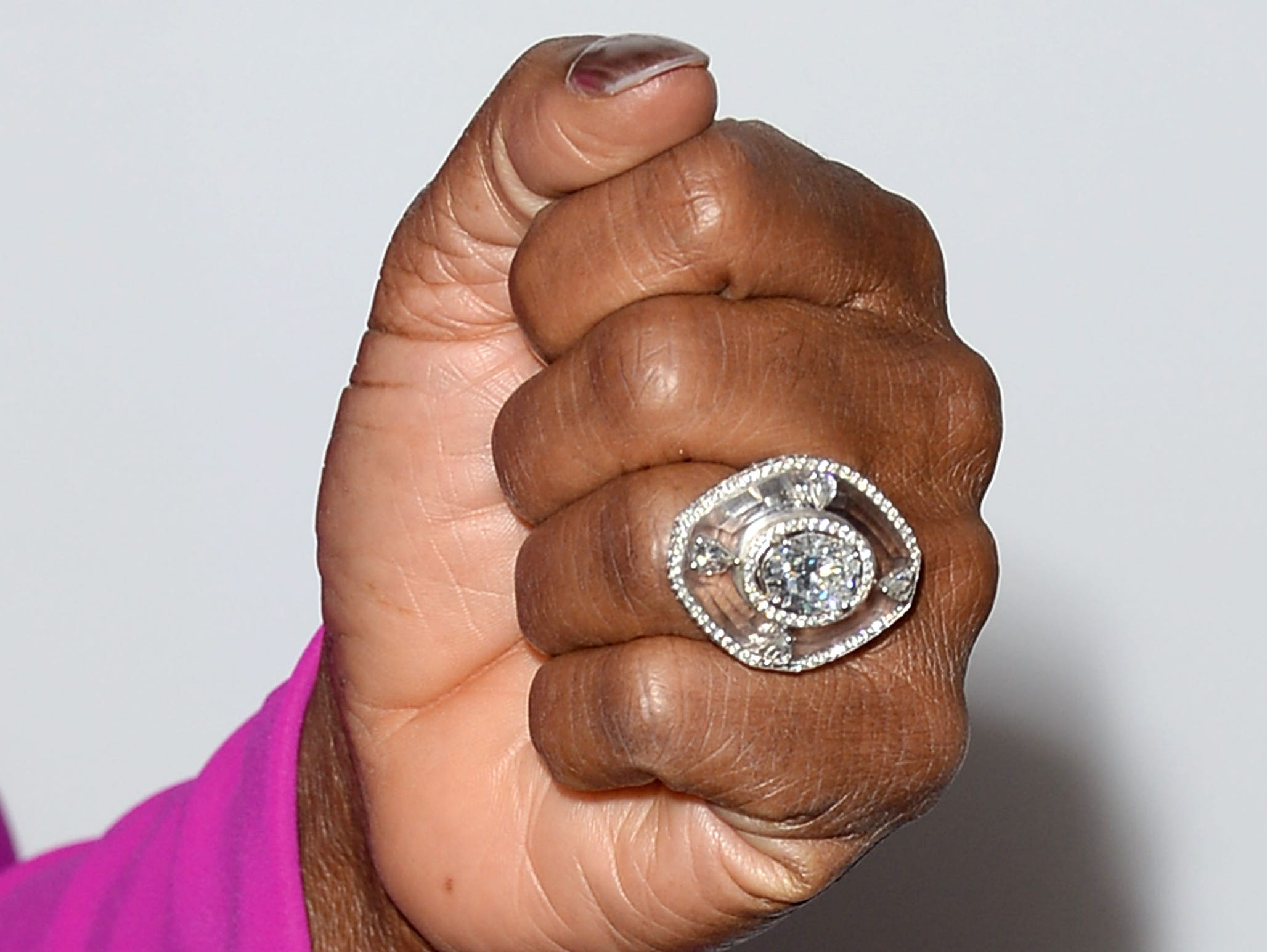 Bam! The media icon makes a major statement with a huge, sure-to-be-chock-full-of-diamonds cocktail ring. Care to guess the price tag on that bauble?!