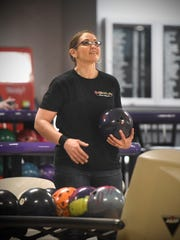 Tracy George checks the scoreboard on Tuesday, May 1 at Great River Bowl.