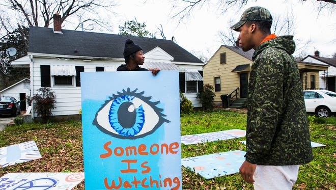 Jaivan Hopson (left), 18, a graduate from Calvine High School in Sacramento, California, and his cousin, Dion Vanhook, 18, a Douglass High School senior, prepare to board up a vacant house on Manhattan Ave. in the Douglass neighborhood on Thursday morning, March 16, 2017. About 60 students from Douglass and Kingsbury high schools, along with volunteers from other youth groups spent most of their spring break fighting blight in North Memphis.