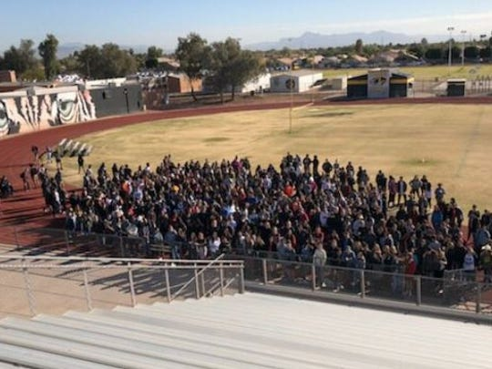 About 200 students at Gilbert High School met at the