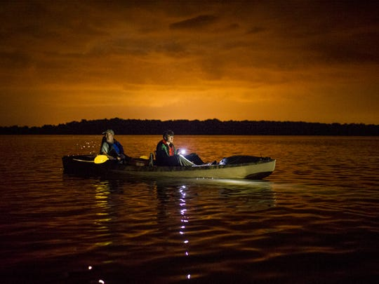 David Uhr and his son Austin Uhr, 16, participate in a moonlight kayak cruise around an island in Lake Fausse Pointe State Park near New Iberia, LA, Thursday, July 3, 2014. The Uhrs and fellow members Boy Scouts of America Troop 383 of Evansville, IN, completed the final leg of their sixty-mile kayak trek through the Atchafalaya Basin as part of the BSA Evangline Area Council's Swamp Base program on Friday, July 4.    Photo by Paul Kieu, The Advertiser