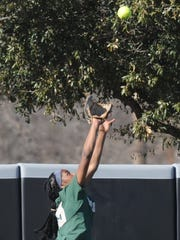 Baylor center fielder Jessie Scroggins leaps to rob