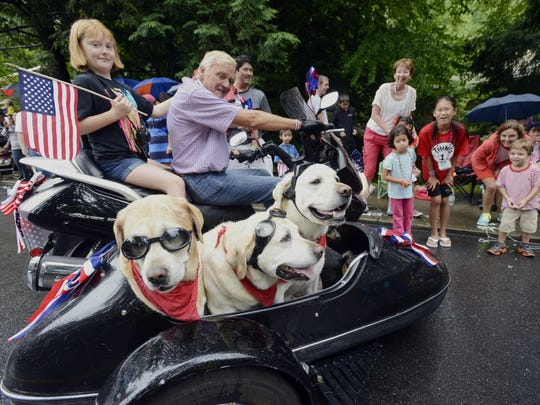 Dr. Johnny Frist of Nasheville, Tennessee, and Elle Chesnutt of Tallahassee, Florida, and their sidecar dogs at the Montreat Fourth of July Parade in 2013.