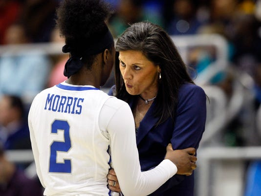 University of Memphis Coach Melissa McFerrin talks with player Loysha Morris (2) in the first half of an NCAA college basketball game against Connecticut, Wednesday, Jan. 13, 2016, in Memphis, Tenn. (AP Photo/Karen Pulfer Focht)
