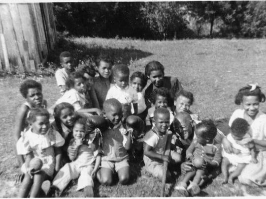 Family picnic at Scott Webster's farm near Lancaster, circa 1930. Included are Gladys Carlisle, Carol Brown, Janet Brown, Martha Belle Jackson, Wanda Liggins, Bobbie Liggins, Stuart Hawkins, Stanley Carlisle, Joe Carlisle and Delores Carlisle.