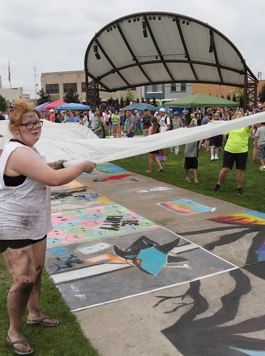 Chalkfest had to be covered up on Saturday as rain approached from the west.