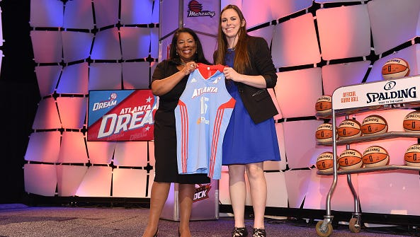 WNBA President Laurel Richie poses with Samantha Logic after being drafted number ten overall by the Atlanta Dream during the 2015 WNBA Draft Presented By State Farm on April 16, 2015 at Mohegan Sun Arena in Uncasville, Conn.