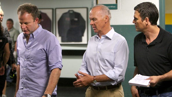"""From left, Director Tom McCarthy, Michael Keaton and Mark Ruffalo film the """"Spotlight"""" movie in the pressroom of the Boston Globe in Boston on Sept. 27, 2014."""