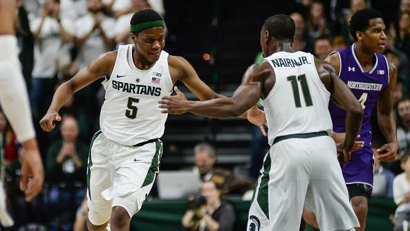Michigan State point guards Cassius Winston (5) and Tum Tum Nairn (11) celebrate a transition basket during the Spartans' 61-52 win over Northwestern on Dec. 30, 2016.