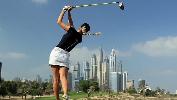 Paige Spiranac of the United States plays her tee shot on the eighth hole during the completion of the first round of the 2016 Omega Dubai Ladies Masters on the Majlis Course at the Emirates Golf Club on Dec. 8, 2016, in Dubai, United Arab Emirates.