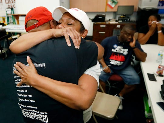 United Auto Workers members, some Nissan employees and supporters express their disappointment at losing their bid to form a union at the Nissan vehicle assembly plant in Canton, Miss., Friday, Aug. 4, 2017.