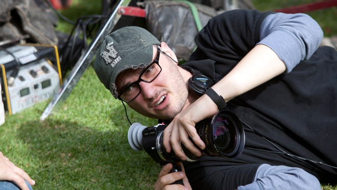 """Director Josh Trank lines up a shot on the set of the motion picture """"Chronicle."""""""