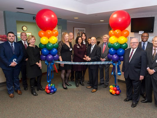 Heartbeats: PROUD Family Health office ribbon cutting PHOTO CAPTION