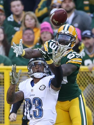 Darius Slay #23 of the Detroit Lions breaks up a pass intended for  James Jones #89 of the Green Bay Packers in the fourth quarter at Lambeau Field on November 15, 2015 in Green Bay, Wisconsin.  The Detroit Lions defeat the Green Bay Packers 18 to 16.