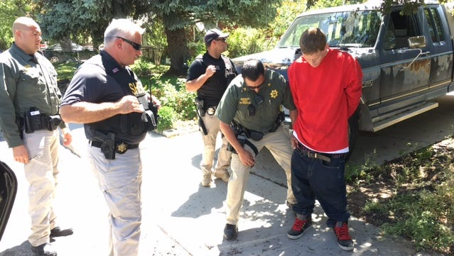 Carson City Sheriff's deputies arrest Cody Rodgers-Shaw on burglary-related charges Thursday in Carson City.