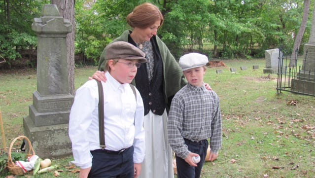Fay Cramton with Noah and Jake Luikart are ready for the cemetery walk, which happens Oct. 9.