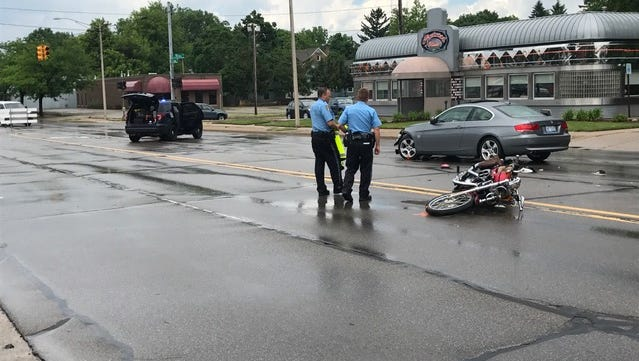 Two people were seriously injured in crash involving a sedan and a motorcycle Friday afternoon (June 1, 2018) on Cedar Street in Lansing.