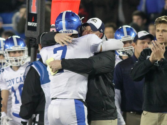 Covington Catholic's head coach Eddie Eviston and A.J. Mayer  react after the  Colonels win  the state championship  , Saturday, Dec. 2, 2017.