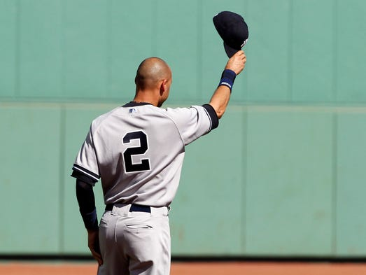 Sept. 28: Derek Jeter tips his cap to the crowd during a pregame ceremony for him at Fenway Park.