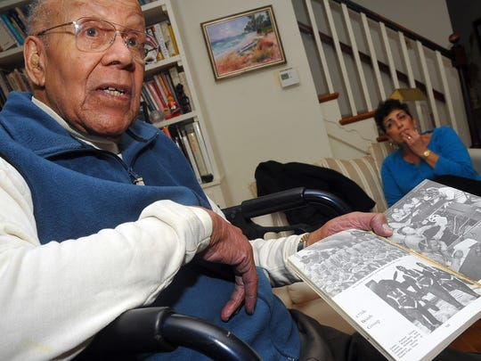 "Fred Johnson, 84, of Wilmington, recounts his time spent as a Tuskegee Airman as he holds up a photo in ""Lonely Eagles"" by Robert A. Rose, D.D.S,  in this file photo taken at his home Wednesday, December 31, 2008."