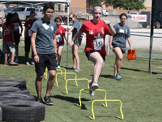 Keely Geisel of Kerrville makes her way through an obstacle course during the 13th annual West Texas Deaf Olympics in which 113 students from San Angelo ISD and area districts competed  at Lake View Stadium Friday, May 5, 2017.