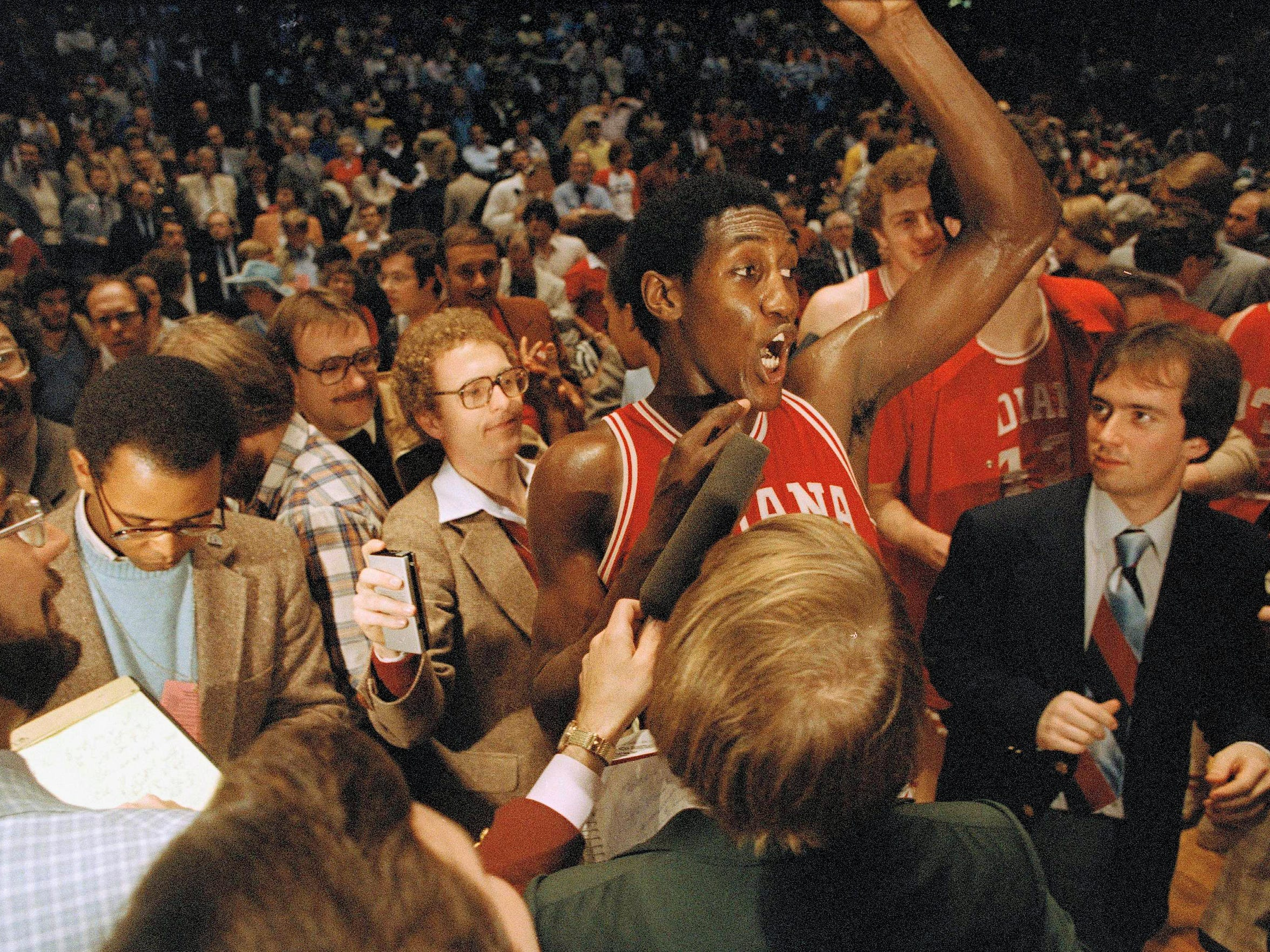 Ray Tolbert is surrounded by newsmen after his team won over North Carolina, 63-50, in the final NCAA championship game, March 31, 1981.