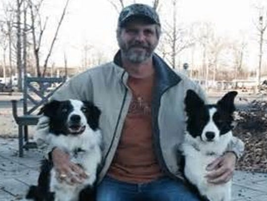 Richard Hartgrove with his dogs, the chief wranglers