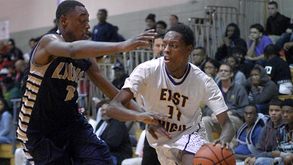 East's Windell Lucas, right, scored 22.2 points per