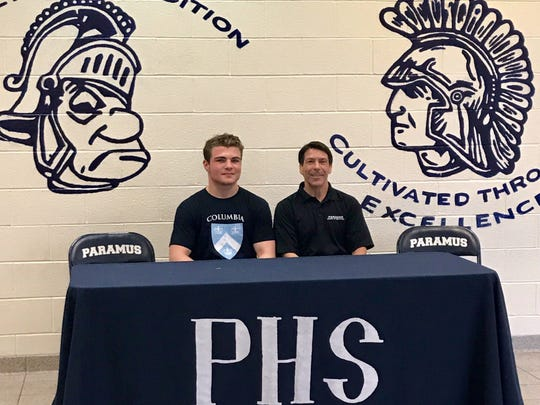 Brian Bonino (left) of Paramus with Coach Massey. Bonino will continue his wrestling career at Columbia University.