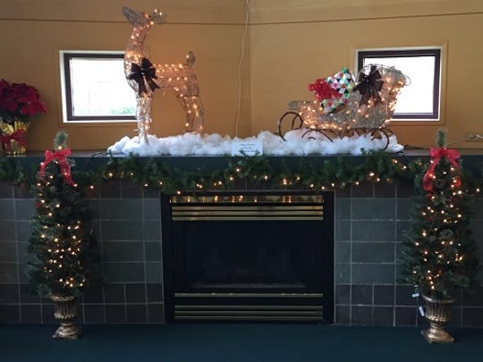 New decorations on the fireplace mantle at the public library in Westland, thanks to a Friends of the Library donation.