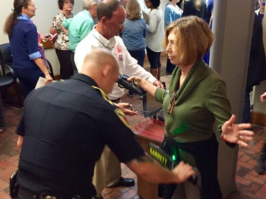 Security screens town hall attendees as they enter
