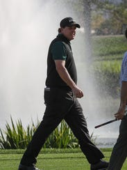Phil Mickelson walks on the 18th hole at the La Quinta