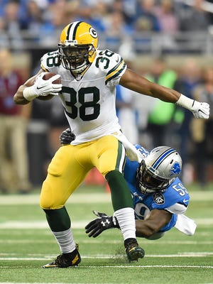 Green Bay Packers running back John Crockett (38) gets by Detroit Lions linebacker Tahir Whitehead (59) while making a run during Thursday night's game at Ford Field in Detroit, Mich. Evan Siegle/Press-Gazette Media